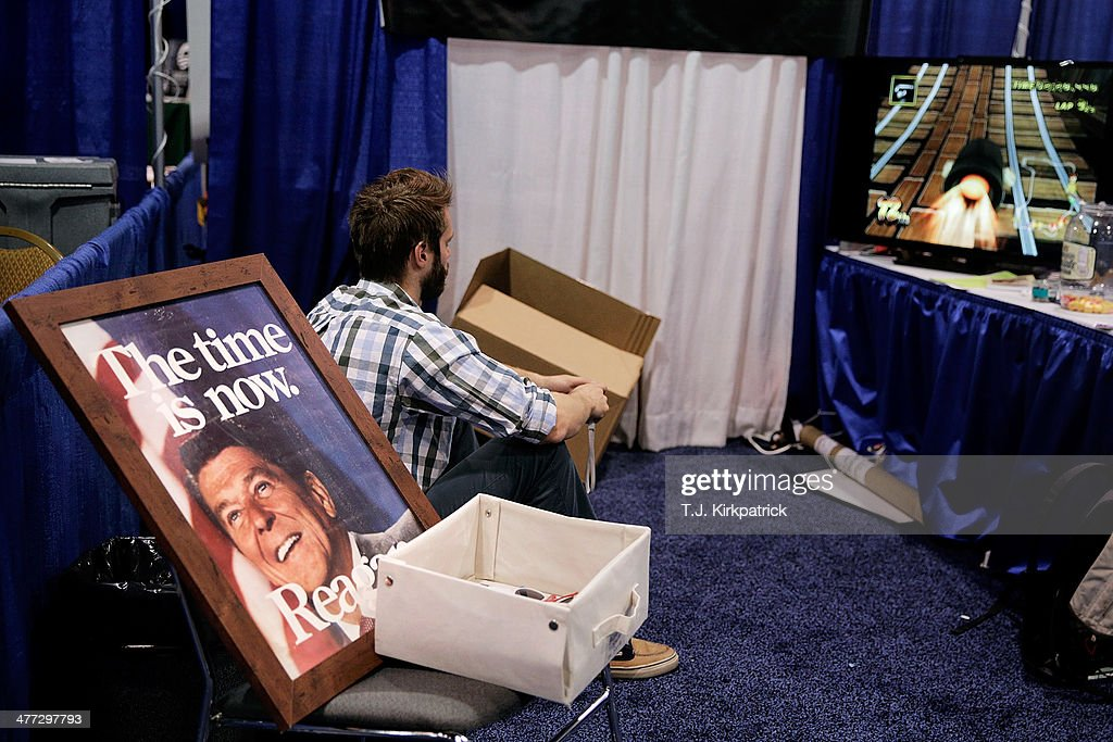 An exhibitor plays a video game in their booth during the 41st annual Conservative Political Action Conference at the Gaylord International Hotel and Conference Center on March 8, 2014 in National Harbor, Maryland. The conference, a project of the American Conservative Union, brings together conservatives polticians, pundits and voters for three days of speeches and workshops.