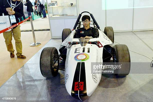 An exhibitor poses in a 3D printed car exhibited at China International Technology Fair on April 23 2015 in Shanghai China About 30% of the overall...