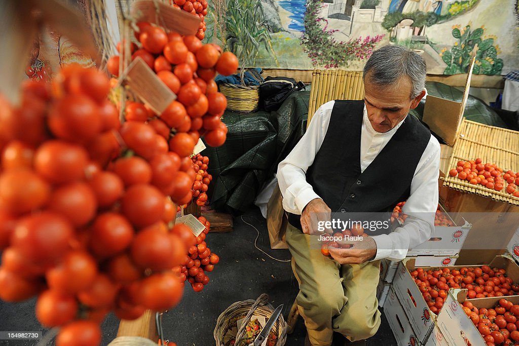 An exhibitor prepare bunches of small tomatoes on a stand at the Slow Food's Salone del Gusto and Terra Madre on October 29, 2012 in Turin, Italy.