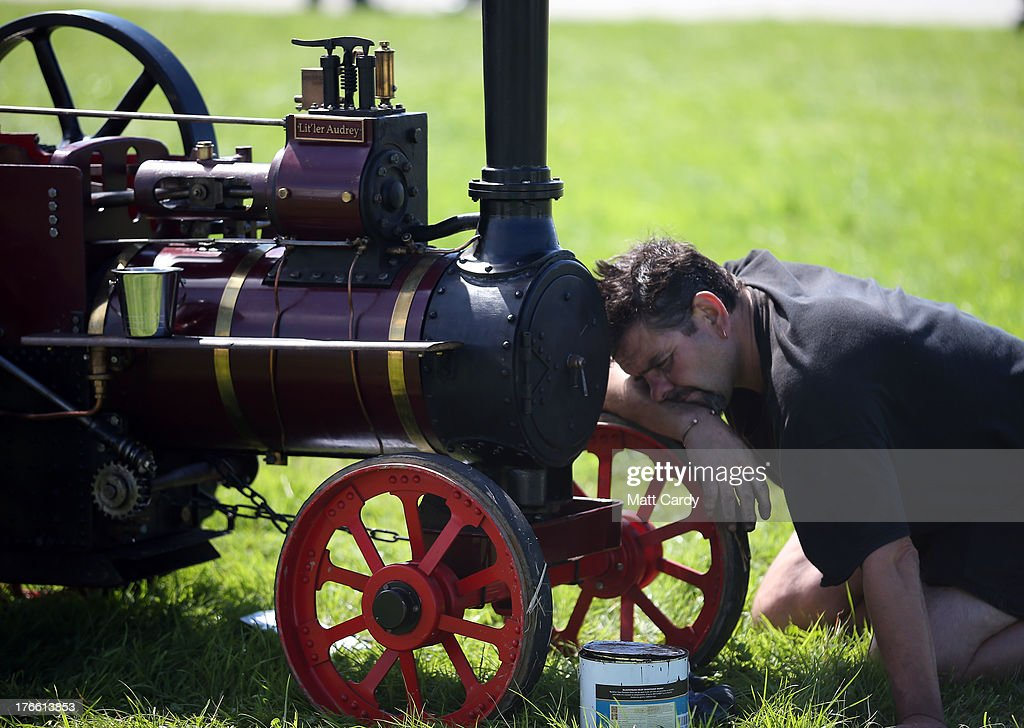 An exhibitor prepares a miniature steam engine to show at the Cornish Steam and Country Fair at the Stithians Showground on August 16, 2013 near Penryn, England. The annual show, now in 58th year, is one of Cornwall's largest outdoor events and is one of the UK's most popular and respected steam rallies.