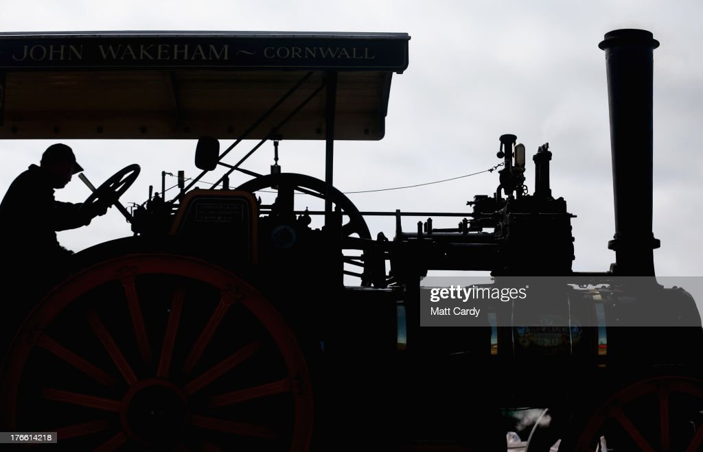 An exhibitor prepares a steam engine to show at the Cornish Steam and Country Fair at the Stithians Showground on August 16, 2013 near Penryn, England. The annual show, now in 58th year, is one of Cornwall's largest outdoor events and is one of the UK's most popular and respected steam rallies.