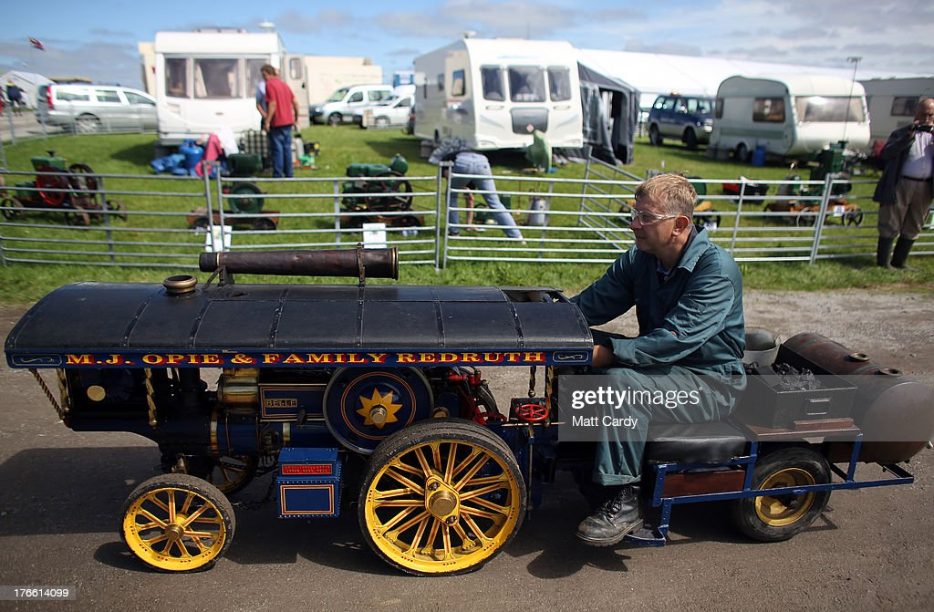An exhibitor rides his miniature steam engine as he shows it at the Cornish Steam and Country Fair at the Stithians Showground on August 16, 2013 near Penryn, England. The annual show, now in 58th year, is one of Cornwall's largest outdoor events and is one of the UK's most popular and respected steam rallies.