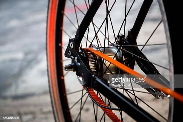 An exhibitor shows on his stand a drive technology at the Berliner Fahrradschau bicycle trade fair on March 22 2014 in Berlin Germany The fair which...