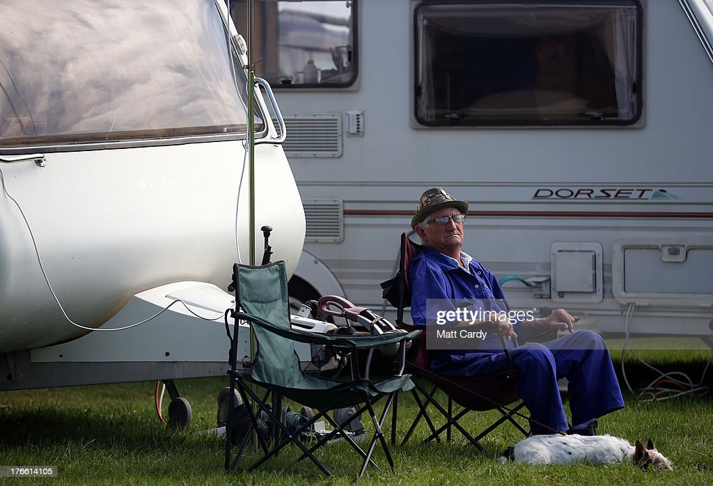 An exhibitor sits besides his caravan as he shows stationary engines at the Cornish Steam and Country Fair at the Stithians Showground on August 16, 2013 near Penryn, England. The annual show, now in 58th year, is one of Cornwall's largest outdoor events and is one of the UK's most popular and respected steam rallies.