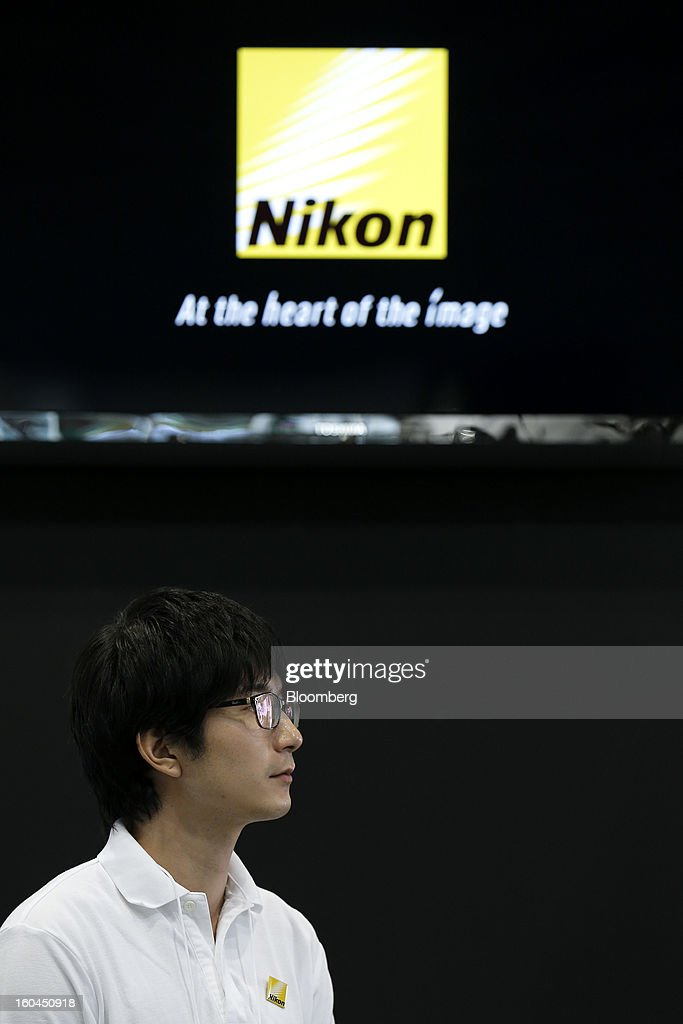 An exhibitor stands at the Nikon Corp. booth during the CP+ Camera and Photo Imaging Show in Yokohama City, Japan, on Thursday, Jan. 31, 2013. The CP+ Camera and Photo Imaging Show runs from Jan. 31 to Feb. 3. Photographer: Kiyoshi Ota/Bloomberg via Getty Images