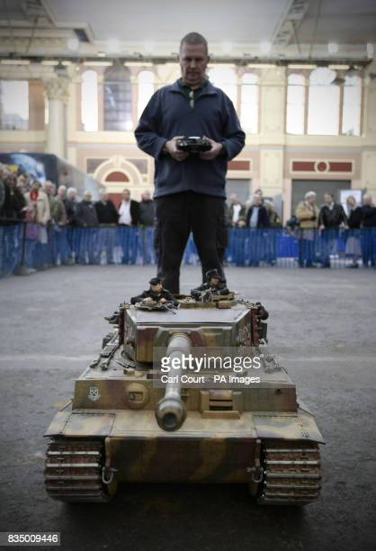 An exhibitor stands behind his remote controlled WW2 German Tiger tank at the London Model Engineering Exhibition 2009 at Alexandra Palace London