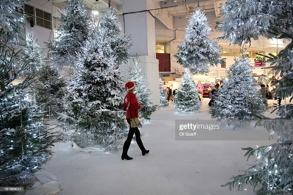 An exhibitor visitor walks through a winter snow scene at the 'Ideal Home Show at Christmas' on November 13, 2013 in London, England. Over 80,000 visitors are expected to attend the 5 day event which showcases a range of gift ideas for Christmas in the Earls Court exhibition centre.