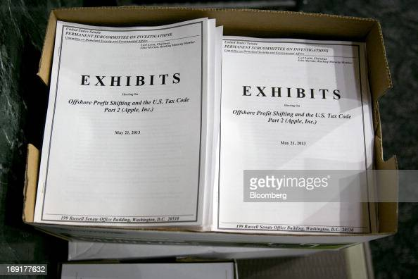 An exhibits booklet for the Senate Permanent Subcommittee on Investigations hearing titled Offshore Profit Sharing and the US Tax Code Part 2 sits in...