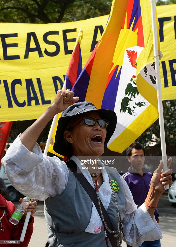 An exiled Tibetan activist holds a Tibetan flag and shouts anti-China slogans during a protest marking the 55th anniversary of the 1959 Tibetan uprising against Chinese rule in India's capital New Delhi on March 12, 2014. Tibetan anger at Beijing's control simmered for decades and erupted into violent riots against Chinese rule in the Tibet regional capital Lhasa and adjacent areas in March 2008. Since 2009, more than 120 Tibetans have set themselves on fire to protest at China's rule and at least 90 have died.