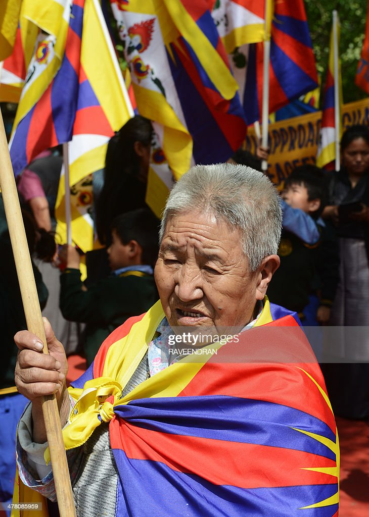 An exiled Tibetan activist holds a Tibetan flag during a protest marking the 55th anniversary of the 1959 Tibetan uprising against Chinese rule in India's capital New Delhi on March 12, 2014. Tibetan anger at Beijing's control simmered for decades and erupted into violent riots against Chinese rule in the Tibet regional capital Lhasa and adjacent areas in March 2008. Since 2009, more than 120 Tibetans have set themselves on fire to protest at China's rule and at least 90 have died.