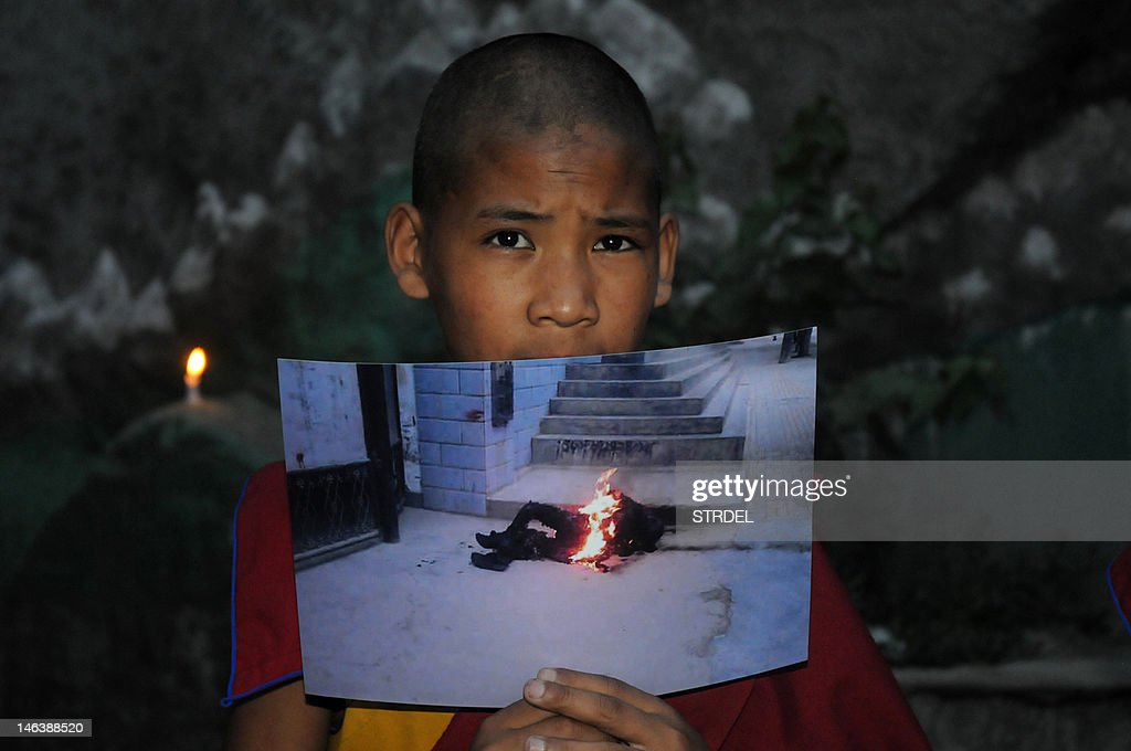 An exiled Tibetan monk holds a picture of 50-year-old, Tamdin Thar, who burned himself to death to protest against the Chinese rule in Tibet during a rally to stand in solidarity with Thar, in McLeod Ganj on June 15 2012. Chinese authorities have said they were investigating the death of a person by self-immolation in a Tibetan area of northwestern Qinghai province, where several Tibetans have in the past year set themselves on fire in protest.
