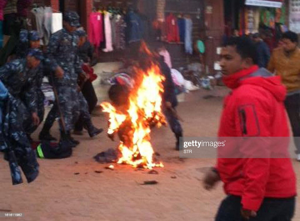 An exiled Tibetan monk sets himself on fire at Boudhanath Stupa in Kathmandu on February 13, 2013. A Tibetan monk doused himself in petrol in a Kathmandu restaurant and set himself on fire, marking the 100th self-immolation bid in a wave of protests against Chinese rule since 2009. Police in the Nepalese capital told AFP that the exile had burned himself in an eatery near Kathmandu's Boudhanath Stupa, one of the world's holiest Buddhist shrines, terrifying tourists who were having breakfast.