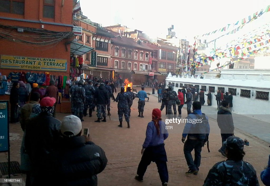 An exiled Tibetan monk sets himself on fire in Boudhanath Stupa in Kathmandu on February 13, 2013. A Tibetan man is in critical condition after setting himself on fire in Nepal, police said, the 100th self-immolation bid since 2009 according to a toll by Tibet's exiled government.