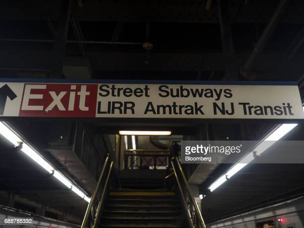 An exit sign is displayed above a Long Island Railroad Co train platform inside Pennsylvania Station in New York US on Friday May 26 2017...