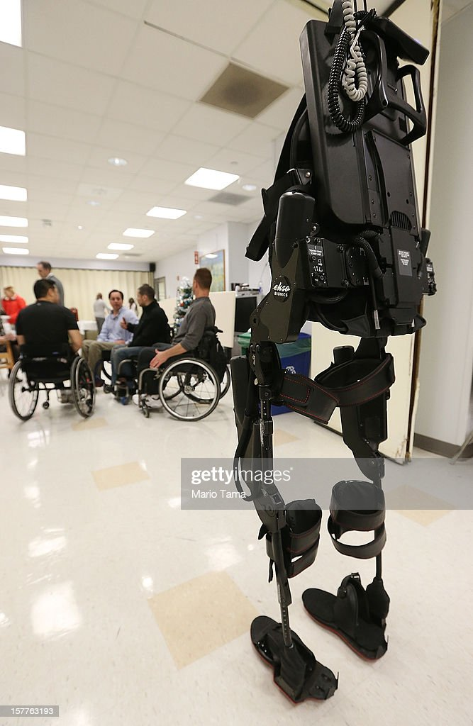 An exoskeleton device made by Ekso Bionics hangs suspended during a demonstration at the opening of the Rehabilitation Bionics Program at Mount Sinai Rehabilitation Center on December 6, 2012 in New York City. Woo is an architect who was paralyzed from the hips down during a construction accident and thought he would never walk again. The new strap-on exoskelton uses motors and sensors to physically move the legs.