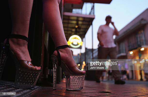 An exotic dancer stands at a club entrance on Bourbon Street on August 31 2012 in the French Quarter of New Orleans Louisiana The Quarter Louisiana's...