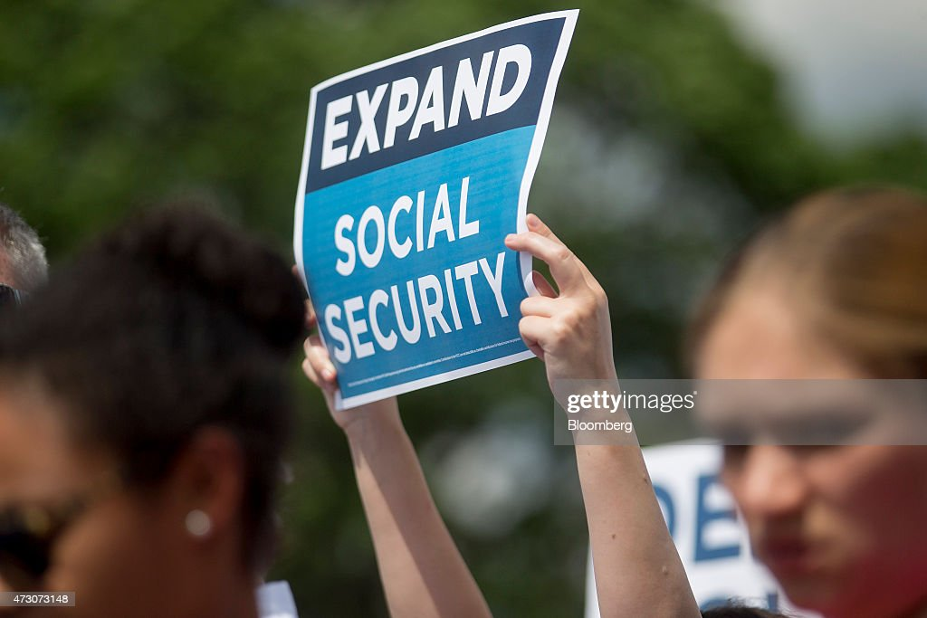 An 'Expand Social Security' sign is held up during a news conference with Bill de Blasio, mayor of New York, not pictured, outside of the U.S. Capitol building in Washington, D.C., U.S., on Tuesday, May 12, 2015. De Blasio unveiled 'The Progressive Agenda to Combat Income Inequality at the news conference.' Photographer: Andrew Harrer/Bloomberg via Getty Images