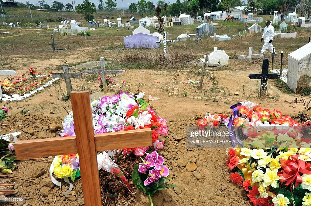 An expert from the Technical Investigation Unit of the Colombian General Attorney's Office walks through the cemetery during exhumation of...