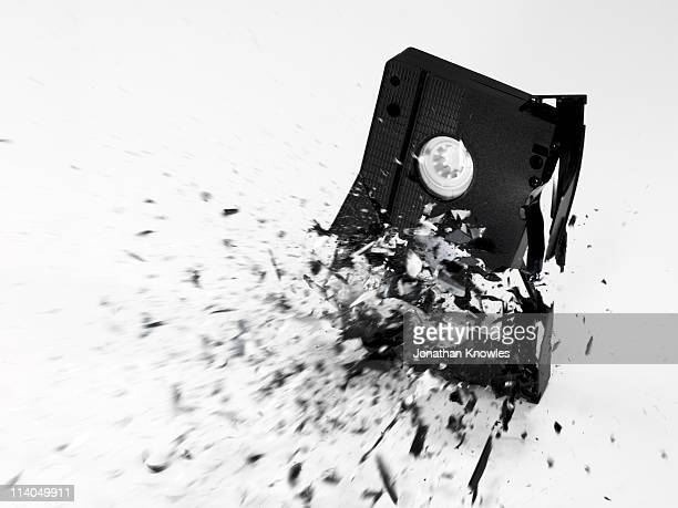 An exploding VHS Tape on a white background