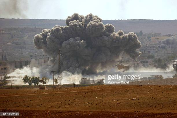 An explosion following an airstrike in the Syrian town of Kobani from near the Mursitpinar border crossing on the TurkishSyrian border in the...