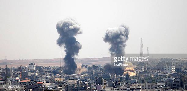 An explosion is seen after an Israeli air strike in Gaza on July 8 2014 Israel launched an offensive against Islamist Hamas in the Gaza Strip on...
