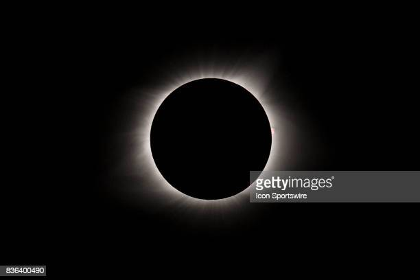 An explosion is seen on the far right of the sun during the total solar eclipse on August 21 at Mary's River Covered Bridge in Chester IL