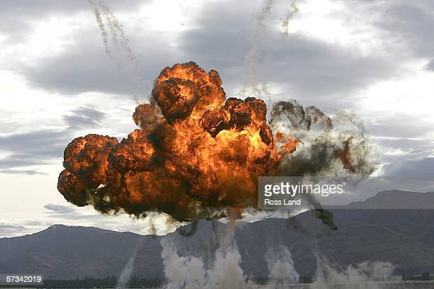 An explosion lights the sky during a mock attack during the 'Warbirds over Wanaka' International Airshow on April 15 2006 in Lake Wanaka New Zealand