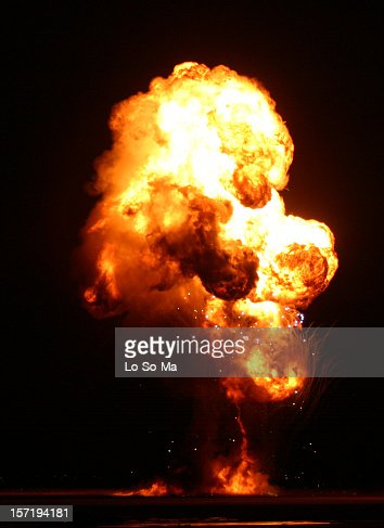 An explosion lit up the darkness with red and yellow flames