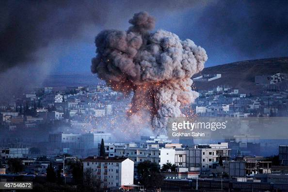 An explosion rocks Syrian city of Kobani during a reported suicide car bomb attack by the militants of Islamic State group on a People's Protection...