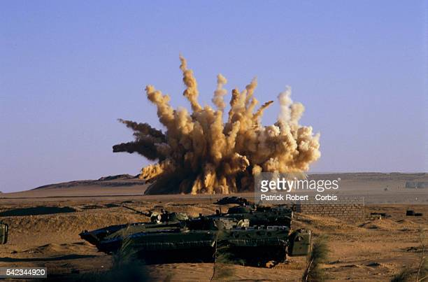An explosion throws sand and smoke into the air near a FANT tank at Wadi Doum Chad FANT the Chadian National Army reconquered the BorkouEnnediTibesti...