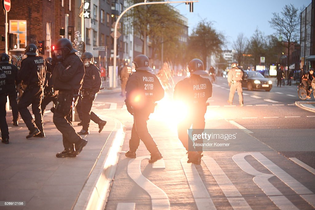 An explosive blasts next to police forces after clashing with leftist protesters on May Day on 01 May, 2016 in Hamburg, Germany. Tens of thousands of people across Germany participated in marches and gatherings by labor unions and in some cities left-wing and anarchist activists took to the streets under heavy oversight by police.