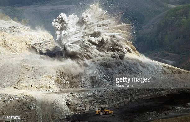 An explosive is detonated at an A G Coal Corporation surface mining operation in the Appalachian Mountains on April 16 2012 in Wise County Virginia...