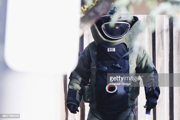 An explosives device detector is sent down the driveway with keys outside service apartments on June 6 2017 in Melbourne Australia Police are...