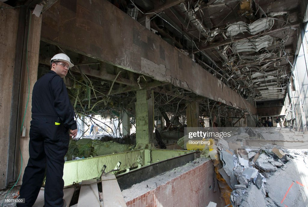An explosives expert inspects the site of the blast at the Petroleos Mexicanos headquarters building in Mexico City, Mexico, on Tuesday, Feb. 5, 2013. Mexican authorities said a buildup of gas led to the blast last week that killed 37 people at Petroleos Mexicanos's headquarters, the first official attempt to explain the nation's deadliest explosion since 2006. Photographer: Susana Gonzalez/Bloomberg via Getty Images