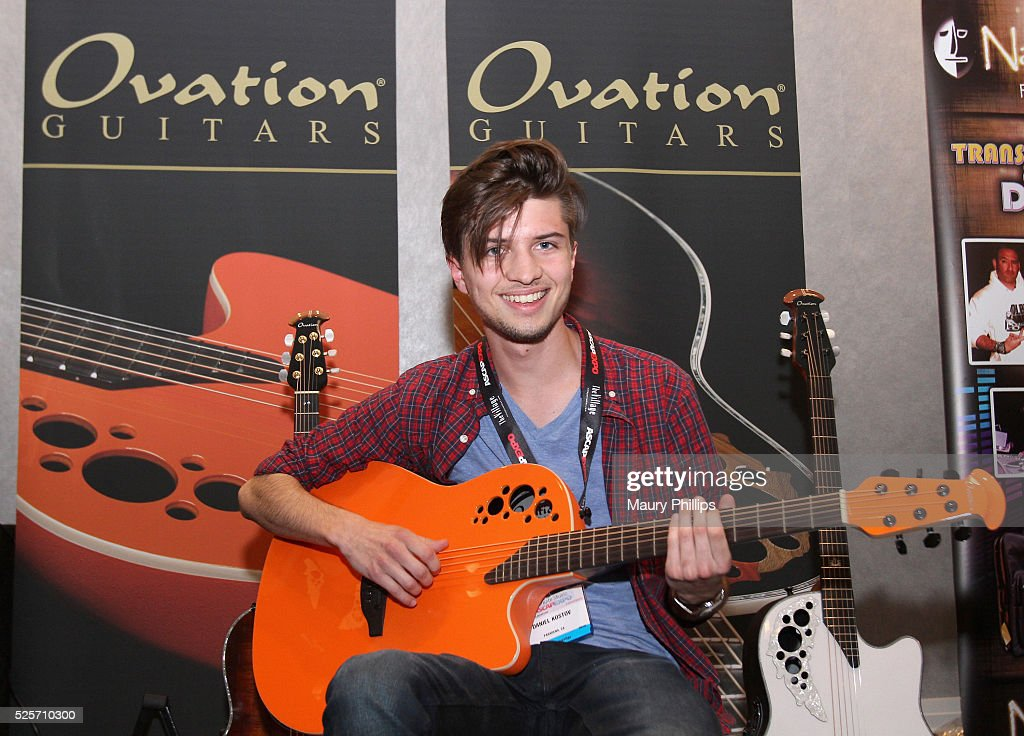 An EXPO attendee plays an Ovation Guitar during the 2016 ASCAP 'I Create Music' EXPO on April 28, 2016 in Los Angeles, California.