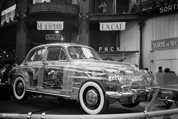 An exposed Simca car reveals all its secrets thanks to its body in Plexiglas during 39th Motor Show at the Grand Palais in Paris on October 1952 /...