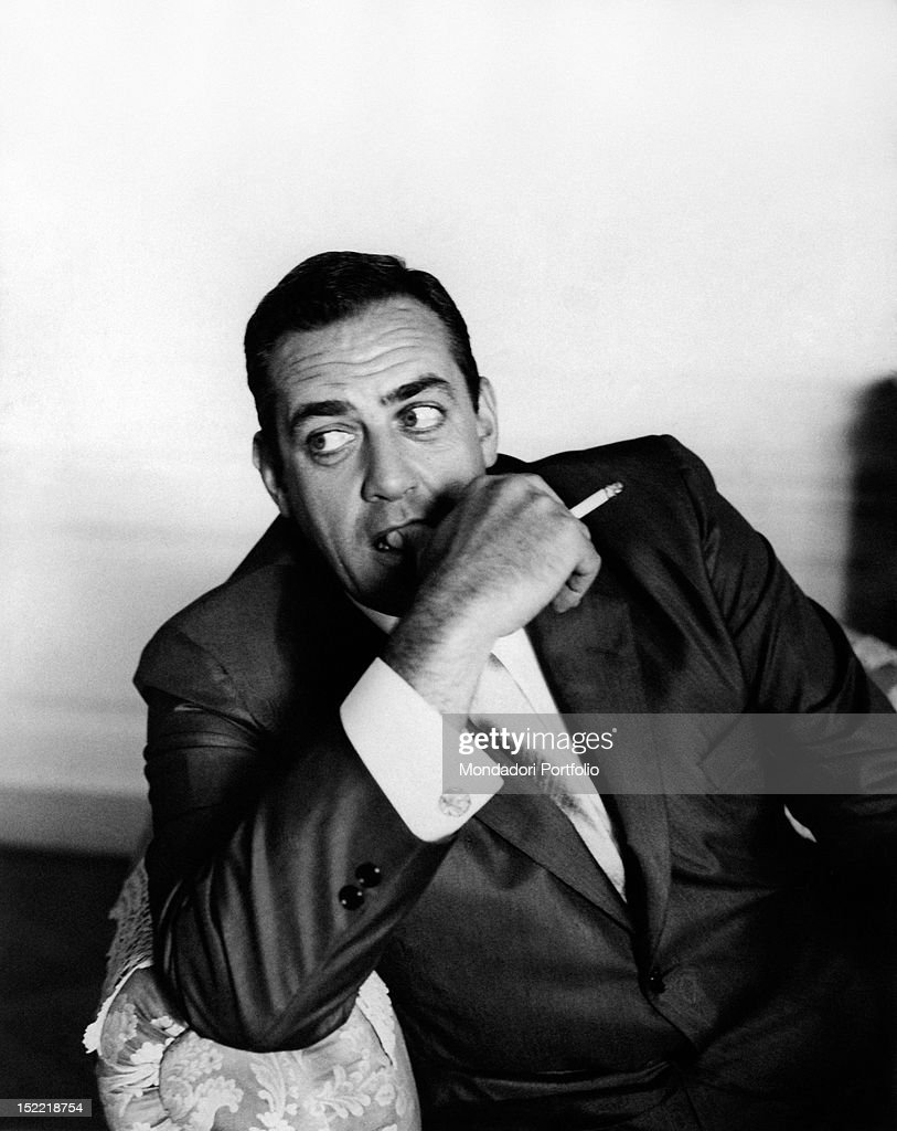 An expressive halfhlengt portrait of American actor Raymond Burr during a journey in Italy here he is smoking a cigarette Italy 1962