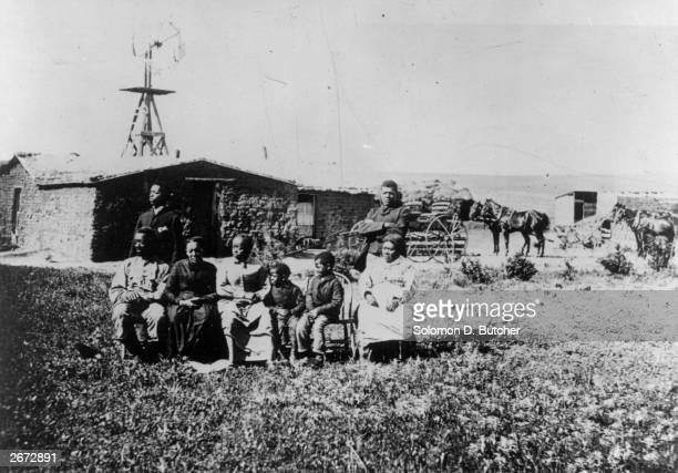 An exslave family outside their house in Nebraska to where many fled in the decades after the American Civil War Original Artwork Photo by Solomon D...