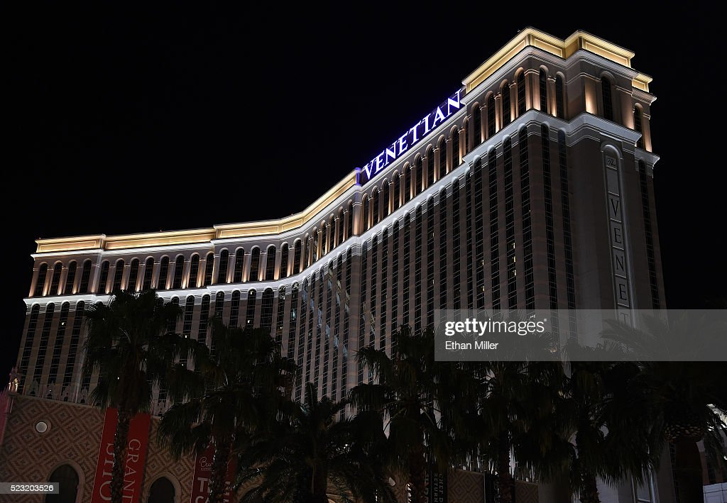 An exterior sign on top of The Venetian Las Vegas is illuminated in purple light in memory of recording artist Prince on April 21 2016 in Las Vegas...
