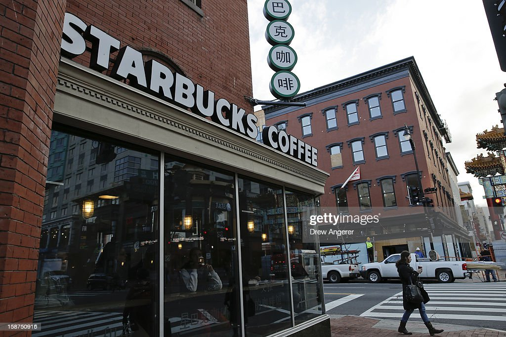 An exterior view of a Starbucks, on December 27, 2012 in the Chinatown neighborhood of Washington, DC. Starbucks CEO Howard Schultz announced Washington locations would serve coffee with the words 'come together' written on the cups intended as a message to lawmakers about the damage being caused by the divisive negotiations over the 'fiscal cliff.'