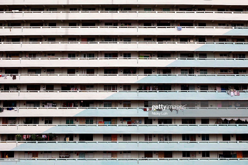 An exterior view of Housing Development apartment flats at the Farrer estate on February 13, 2013 in Singapore. The government white paper revealed Singapore's population may increase 30% to over 6.9 million by 2030, with nearly half the population expected to be foreign-born. Many local residents are critising the plan concerned about the added strain on housing, transportation and healthcare and the diminishing identity of the Singaporean community.
