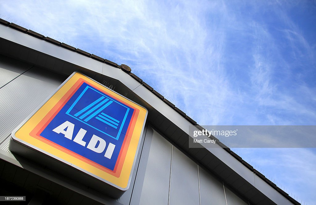 An exterior view of signage at a branch of the budget supermarket Aldi on November 7, 2013 in Bristol, England. As the German chain opens its 500th store in the affluent Bury St Edmunds, some retail experts are claiming that the low-cost supermarket is trying to attract more affluent shoppers, in particular by offering large discounts on luxury items.