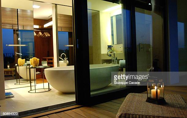 An exterior view of the bathroom thru a sliding glass door at the new Bulgari Hotel is seen on May 18 2004 in Milan Italy Bulgari Hotels and Resorts...