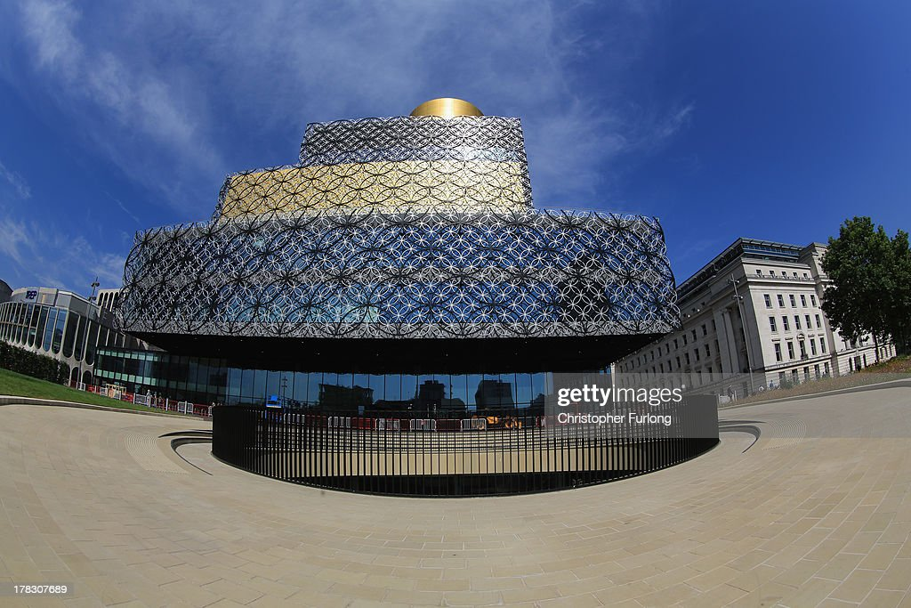 An exterior view of the new Library of Birmingham and it's outdoor ampitheatre at Centenary Square on August 27, 2013 in Birmingham, England. The new futuristic building designed by architect Francine Hoube officially opens on September 3 and has cost 189 million GBP. The modern exterior of interlacing rings reflects the canals and tunnels of Birmingham. The library's ten floors will house the city's internationally important collections of archives, photography and rare books as well as it's lending library.