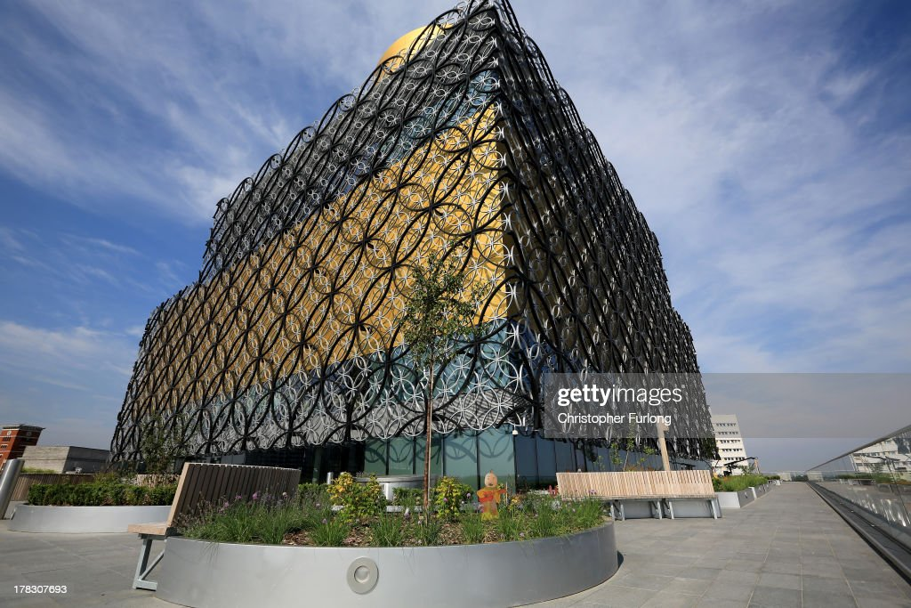 An exterior view of the new Library of Birmingham and it's outdoor roof terrace garden at Centenary Square on August 27, 2013 in Birmingham, England. The new futuristic building designed by architect Francine Hoube officially opens on September 3 and has cost 189 million GBP. The modern exterior of interlacing rings reflects the canals and tunnels of Birmingham. The library's ten floors will house the city's internationally important collections of archives, photography and rare books as well as it's lending library.