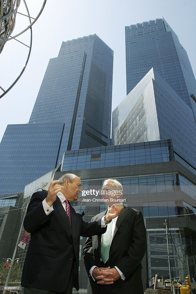 An exterior view of the new Time Warner Building is seen in Columbus Circle behind architect Howard Elkus (R) and developer Ken Himmel (L) April 29, 2004 in the Manhattan borough of New York City. The building houses many businesses including the Time Warner World Headquarters, CNN offices, Five Star Mandarin Oriental Hotel, One Central Park Luxury Residences, restaurants and mall type shopping stores.