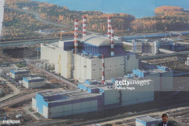 An exterior view of the nuclear island of BN 800 the Russian fast Breeder Reactor is displayed on a large poster on June 27 2017 in Zarechny Russia...