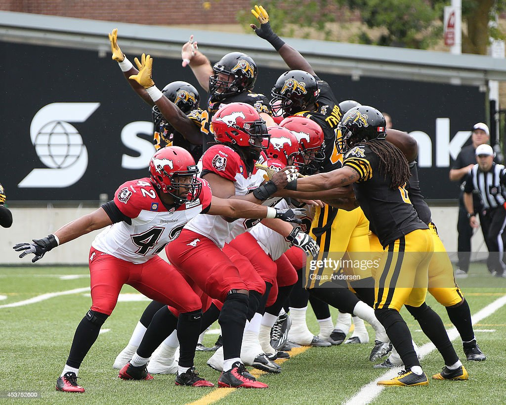 An extra point attempt during play between the Hamilton TigerCats and the Calgary Stampeders in a CFL game at Ron Joyce Stadium on August 16 2014 in...