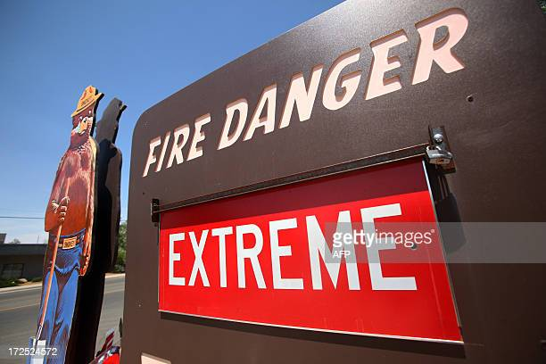An extreme fire danger sign is pictured outside of the Prescott Fire Station 1 on July 2 2013 in Prescott Arizona The Yarnell Hill fire which killed...