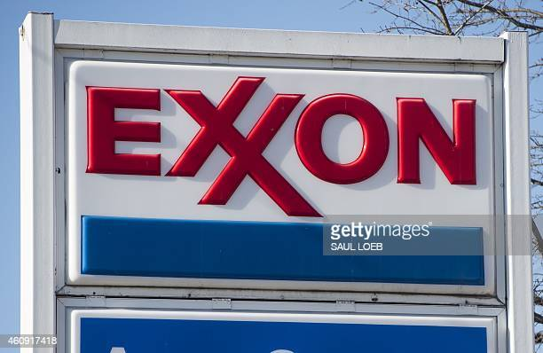 An Exxon gas station is seen in Falls Church Virginia December 30 2014 AFP PHOTO / SAUL LOEB